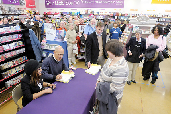 """Don Knight / The Herald Bulletin<br /> Former Colts coach Tony Dungy and his wife Lauren sign copies of their new book """"Uncommon Marriage"""" at the Family Christian bookstore in Anderson on Tuesday. Hundreds turned out for the event."""