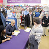 "Don Knight / The Herald Bulletin<br /> Former Colts coach Tony Dungy and his wife Lauren sign copies of their new book ""Uncommon Marriage"" at the Family Christian bookstore in Anderson on Tuesday. Hundreds turned out for the event."