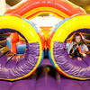 Don Knight / The Herald Bulletin<br /> Ella Crawford, 6, runs through an inflated obstacle course at Bonzo's Fun Zone inside the Mounds Mall on Thursday. Temperatures were in the teens on Thursday but are forecast to warm a little over the weekend but with that comes a chance for more snow.