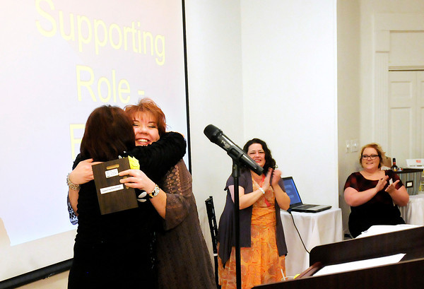 """Don Knight / The Herald Bulletin<br /> Karen Sipes, left, hugs Gretchen Baldwin after Baldwin was named best Actress in a Supporting Role during Mainstage Theatre's """"2014 Star Night"""" at The Edge on Saturday."""
