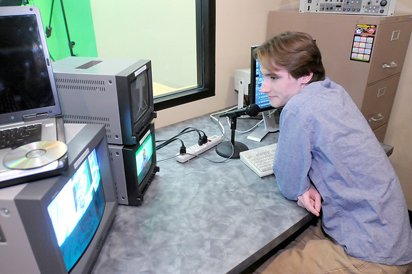 Don Knight / The Herald Bulletin<br /> Alex Webster directs from the control room of a TV studio at the City Building on Tuesday. The equipment was originally used at the Ebbert Education Center before being moved to the Wigwam before it was closed.