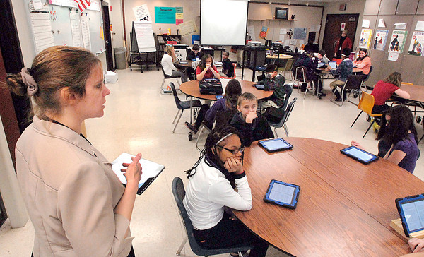 THB photo/John P. Cleary<br /> Milissa Crum, Highland Middle School 6th grade English teacher, asks questions to her class about the story they are reading on their i-pads Friday.