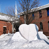 Don Knight / The Herald Bulletin<br /> A parishioner at First Church of the Nazarene sculpted this heart out of snow in front of the church's Jackson Street entrance.