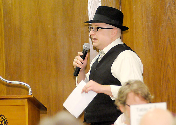 Don Knight / The Herald Bulletin<br /> Luke Renner gives the remarks for the Class of 2014 during the Leadership Academy of Madison County's annual graduation dinner at the Anderson Country Club on Thursday.
