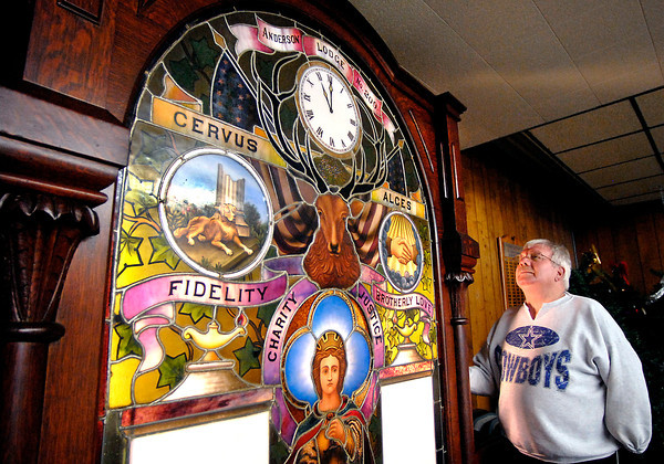 THB photo/John P. Cleary<br /> Dick Dunn, Anderson Elks Lodge 209 secretary, looks over the 1903 leaded glass covered chimes that was used in the lodges' 11 o'clock toast ceremony as he prepares the lodge for a liquidation sale of all their items.  After 121 years the Anderson lodge has folded.