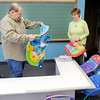 Don Knight / The Herald Bulletin<br /> Church Elder Steve Gasaway and his wife Pam prepare the nursery at Journey Church on Friday. While the circumstances of the Journey Church's move have been difficult Pam said the fellowship from hours spent remodeling the former Meadowbrook School has brought the congregation closer together.