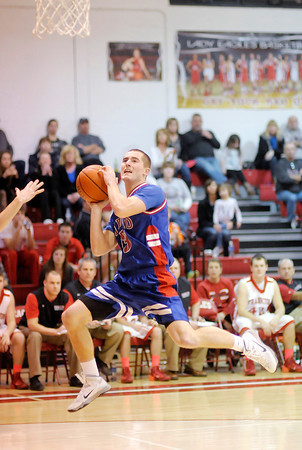 Don Knight / The Herald Bulletin<br /> Elwood's London Leavell looks to shoot after drawing a foul from Frankton's  Austin Compton on a fast break as the Eagles hosted the Panthers on Friday.