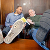 """THB photo/John P. Cleary<br /> Eddie Robinson, director of development for the Christian Center, and Neal Kirby, executive director Christian Center, go over details for the first """"Walk a Mile In My Shoes"""" event to be held this Saturday."""