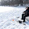 Don Knight / The Herald Bulletin<br /> Terry Conner of Marion fishes through the ice of Shadyside Lake on Saturday. Conner was catching bluegill in about 16 feet of water.