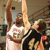 Photo by Chris Martin for THB<br /> Anderson's Kobe Clay makes a shot over Lebanon's Nick Starkey