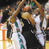 Don Knight / The Herald Bulletin<br /> From left, Anderson's Shantez Goolsby and Kez'Aniqu Gosha double team   Mt. Vernon's Erica Moore during the sectional championship at Connersville on Saturday.