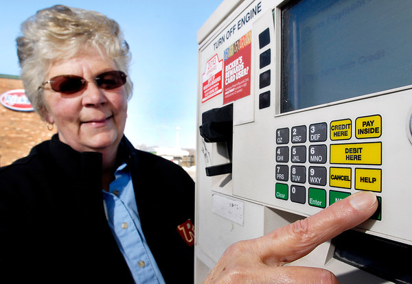 THB photo/John P. Cleary<br /> Judy Eaglin, manager of the Ricker's at 5408 Martin Luther King Blvd. in Anderson, shows the help button on their pumps for people with special needs   that need assistance in pumping their fuel.