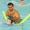 Mark Maynard / For The Herald Bulletin<br /> Dr. Neel Desai plays with his son Ethan, who has O I, in the Anderson Express Holiday Inn pool.