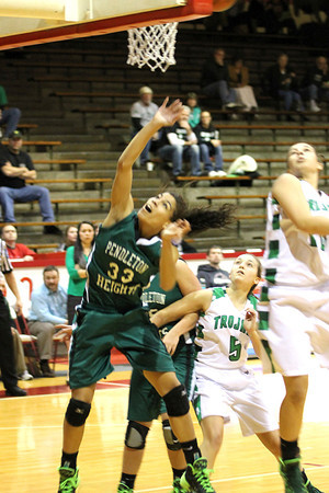 Chris Martin for THB/ Pendleton Height's Kiawna Cottrell goes up for a rebound against New Castle defenders.