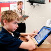 THB photo/John P. Cleary<br /> Dakota Morris scrolls down on his i-pad as he follows teacher Milissa Crum as they read a story in their 6th grade English class at Highland Middle School Friday.