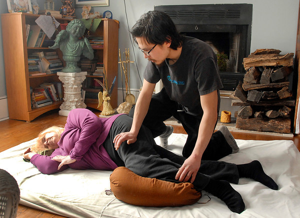 """THB photo/John P. Cleary<br /> Josh Medlin gives a Shiatsu session to client Mary Harte.  Shiatsu means """"finger-pressure"""" and originated from Japan."""
