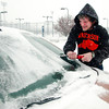 THB photo/John P. Cleary<br /> Marc St. Amour, a track coach with Anderson University, cleans his windshield of snow and ice as he leaves campus Tuesday afternoon.