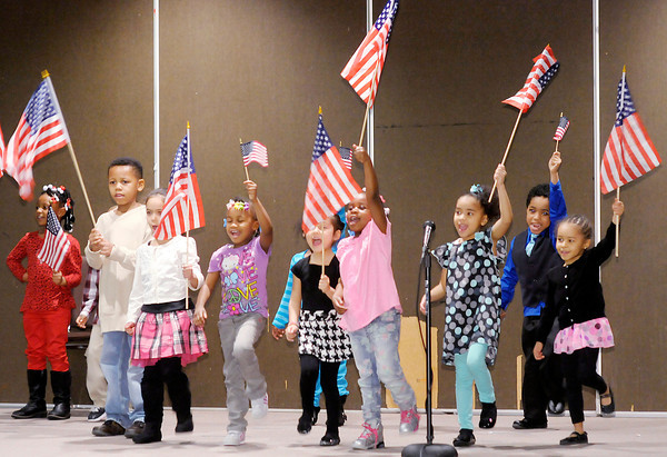Don Knight / The Herald Bulletin<br /> Preschoolers from the Excel Learning Academy wave flags as they pay tribute to President Barack Obama and First Lady Michelle Obama during their Black History Program on Thursday.