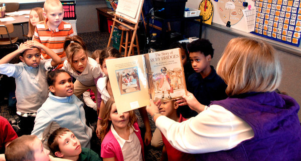 "THB photo/John P. Cleary<br /> Carlynn Malone teaches about black history in her Valley Grove 2nd grade class.  Her focus is on character building and uses stories about individuals and their character.  Here her students react to the illustrations in the book ""The Story of Ruby Bridges"" as she reads the story to the class."