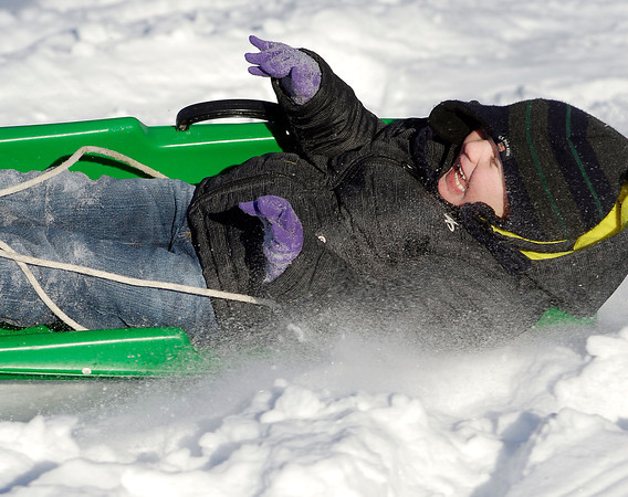 THB photo/John P. Cleary<br /> Kendyn Enterkin, 4, is all smiles and giggles as he slides down the hill at Shadyside Park Monday afternoon on his first ever outing to go snow sledding.  Kendyn's grandfather, Brian White, took him sledding for the first time and little Kendyn couldn't wait to climb to the top to go again, and again!