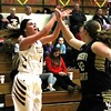 Chris Martin for The Herald Bulletin<br /> Alexandria's Paxton Quinn takes a 3 pointer from the corner in a home game Thursday night against Madison-Grant