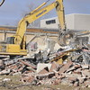 John P. Cleary | The Herald Bulletin<br /> Demolition of St. Vincent Anderson Regional Hospital's old outpatient surgery center has started since the opening of their new surgery pavilion last month.  The outpatient surgery center was opened in 1986 and closed at the end of December.  The area will be used for parking as well as a healing garden.