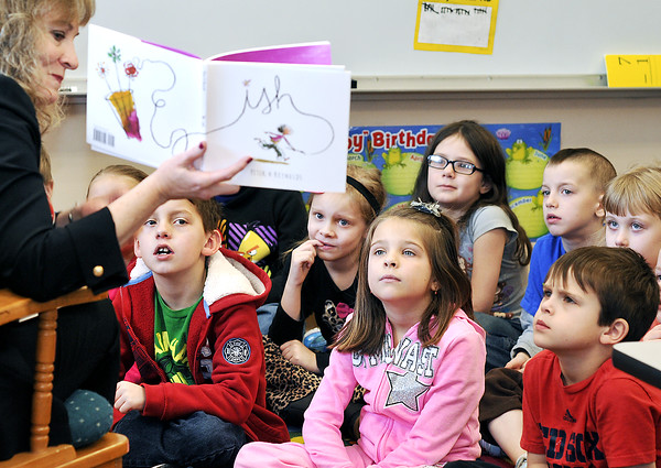 John P. Cleary | The Herald Bulletin <br /> All eyes are looking forward from Shayna Salway's first grade students at Frankton Elementary School as State Superintendent of Public Instruction Glenda Ritz reads to the class Monday morning.