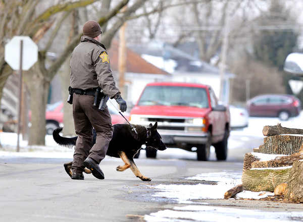 John P. Cleary | The Herald Bulletin<br /> Police searched the area of Poplar and Claire Streets in north Anderson Wednesday with K-9's for suspects involved in a shooting Wednesday morning.