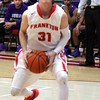 Chris Martin for The Herald Bulletin<br /> Frankton's Austin Compton goes in for a layup Tuesday night against Muncie Central