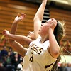Chris Martin for The Herald Bulletin<br /> Alexandria's Mackenzie McCarty puts back an offensive rebound Thursday night against Madison-Grant