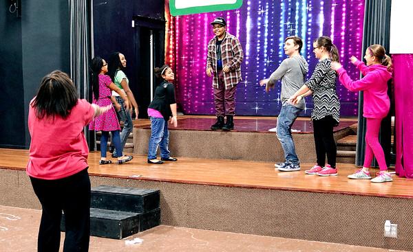 "Mark Maynard   for The Herald Bulletin<br /> Alexandria Commons Theatre Choreographer Donna McFadden coaches  a group of ""Hairspray Jr."" actors on their dance moves."