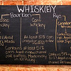 Don Knight | The Herald Bulletin<br /> An explanation of the different types of whisky hangs in the bar at Madison's in Pendleton. The restaurant is holding a whisky tasting and education event on March 7th.