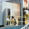 John P. Cleary    The Herald Bulletin<br /> Anderson Firefighters battle a insulation fire in the ceiling of the former GM Plant 20 building Monday that was sparked by construction work. Sutong China Tire Resources is opening a distribution center in the building at 2812 East 38th Street.