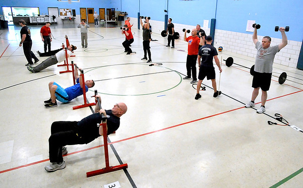 John P. Cleary |  The Herald Bulletin<br /> Area firefighters hit different workout stations as they go through the International Association of Firefighters Peer Fitness Trainer Workshop being held this week in Anderson at the UAW Union Hall.