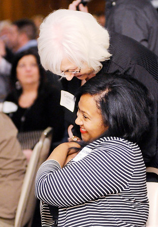 Don Knight   The Herald Bulletin<br /> Carlene Westerfield-Gunter hugs Stephanie Wade after sharing how Wade's positive attitude had affected her during Leadership Academy's graduation dinner at the Anderson Country Club on Thursday.