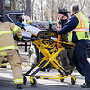 Don Knight | The Herald Bulletin<br /> AFD moves a patient to a waiting ambulance after a collision between a car and a train at the crossing on Brown Street Tuesday afternoon.