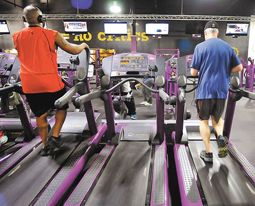 John P. Cleary |  The Herald Bulletin People can watch the TV's as they workout on the treadmills at Planet Fitness Anderson, voted Best Fitness Facility in the THB Best Of voting.