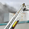 John P. Cleary |  The Herald Bulletin<br /> Anderson Firefighters battle a insulation fire in the ceiling of the former GM Plant 20 building Monday that was sparked by construction work. Sutong China Tire Resources is opening a distribution center in the building at 2812 East 38th Street.