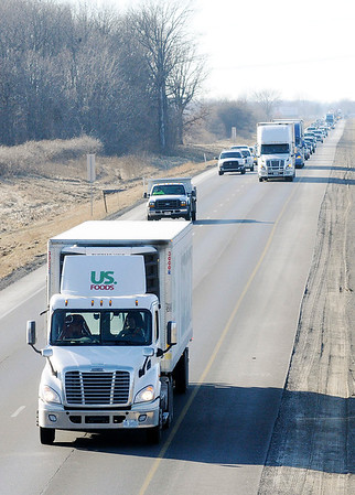 Don Knight | The Herald Bulletin<br /> Traffic travels northbound on Interstate 69 south of Pendleton on Friday. The Indiana Department of Transportation is extending work on the adding of a third travel lane in each direction to just north of Exit 222, the first Anderson exit.