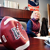 John P. Cleary |  The Herald Bulletin<br /> JoAnna Collette, executive director of JobSource, is a big Patriots fan with her office full of Patriot memorabilia and even includes a deflated football she keeps on her desk.