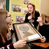 John P. Cleary |  The Herald Bulletin<br /> Alexandria-Monroe High School junior Spanish students Cassidy Garner, Harleigh Bowers, and Savannah Owens discuss their upcoming summer abroad trip as they look at items from past trips in their classroom.