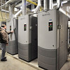 John P. Cleary |  The Herald Bulletin<br /> Stan Davis, head of maintenance for Madison-Grant United School Corp., checks one of the boilers of the heating system that has been upgraded already.