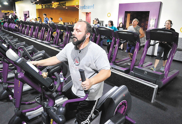 John P. Cleary    The Herald Bulletin<br /> Mike Johnson, of Anderson, works out on an elliptical machine at Planet Fitness Anderson. Planet Fitness was voted best fitness facility in the THB Best Of voting.