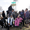 Don Knight | The Herald Bulletin<br /> Mayor Thomas Broderick Jr. and members of Marietta Wright's family look up as a sign honoring Wright is unveiled along a section of 14th Street that was dedicated to her memory in a ceremony on Friday. Wright touched many lives as she gave generously of her time and talent to help the community.