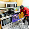 Don Knight   The Herald Bulletin<br /> Executive Chef LA looks in one of the new ovens at Bridges of Hope. The new rehabilitation center has opened in the former Madison Park Church of God location on North Madison Avenue.