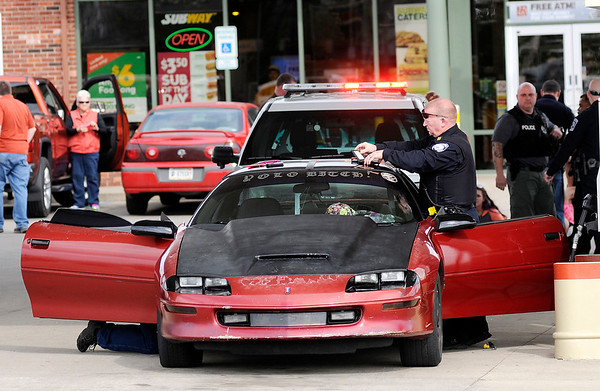 Don Knight | The Herald Bulletin<br /> Police detained five people following a police chase that ended at the Ricker's at 53rd and Dr. Martin Luther King Jr. Boulevard on Friday.