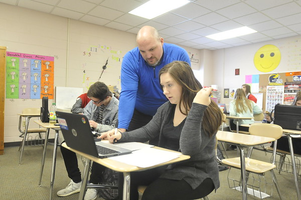 John P. Cleary |  The Herald Bulletin<br /> Frankton Jr.-Sr. high School math teacher Justin Fisher working with students in his pre-calculus class.