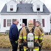 John P. Cleary |  The Herald Bulletin<br /> Anderson firefighters gather details after fighting a fire in this two-story house in the 1600 block of Poplar Street Tuesday afternoon. There were no injuries reported.