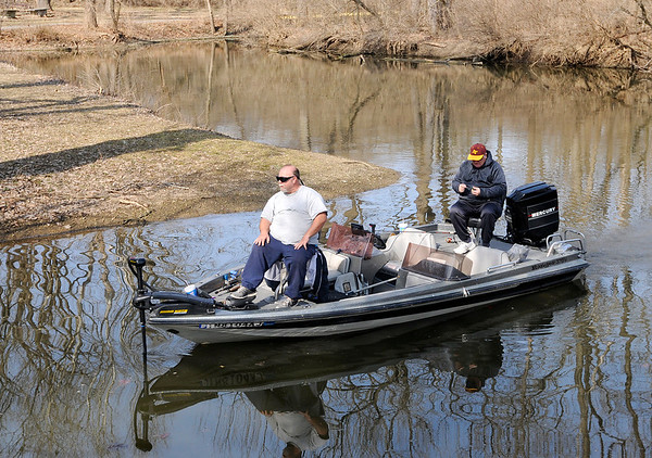 Don Knight   The Herald Bulletin<br /> A pair of anglers navigate the channel that connects the north and south pools of the lake at Shadyside park on Saturday. The weather over the weekend was unseasonable warm and is forecast to stay warm for the week ahead.