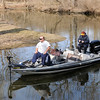 Don Knight | The Herald Bulletin<br /> A pair of anglers navigate the channel that connects the north and south pools of the lake at Shadyside park on Saturday. The weather over the weekend was unseasonable warm and is forecast to stay warm for the week ahead.